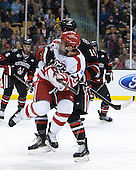 Ben Rosen (BU - 8), Braden Pimm (NU - 14) - The Northeastern University Huskies defeated the Boston University Terriers 3-2 in the opening round of the 2013 Beanpot tournament on Monday, February 4, 2013, at TD Garden in Boston, Massachusetts.