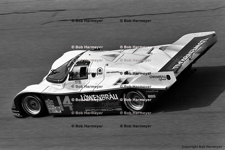DAYTONA BEACH, FL: The Holbert Racing Porsche 962 103 of Al Unser, Jr., Derek Bell and Al Holbert is driven on the Turn 4 banking during the 24 Hours of Daytona on February 3, 1985, at the Daytona International Speedway in Daytona Beach, Florida.