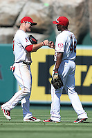 09/13/12 Anaheim, CA: Los Angeles Angels center fielder Mike Trout #27and right fielder Torii Hunter #48 during an MLB game played between the oakland Athletics and Los Angeles Angels at Angel Stadium. The Angels defeated the A's 6-0.