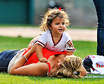 19 June 2011: Washington Nationals' pitcher Jason Marquis' daughter Alexis joins him on the field, crawling on Mom Debbie, after a Father's Day game against the Baltimore Orioles at Nationals Park in Washington, District of Columbia. The Orioles defeated the Nationals 7-4 in inter-league play, and ended Washington's 8-game winning streak. Mandatory Credit: Ed Wolfstein Photo