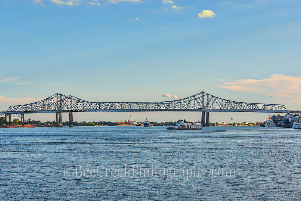Mississippi River ibridge n New Orleans as one of the ferry crosses over to the landing.