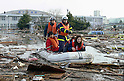 University Workers Rescued by boat at Iwanuma, Miyagi Prefecture on the morning of March 12th, 2011 after a series of earthquakes and tsunami hit Japan's North East coast on Friday 11th March, 2011.