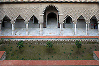 High angle view of Patio de las Doncellas (Courtyard of the Maidens), Real Alcazar, Seville, Spain, pictured on December 26, 2006, in the morning. The Real Alacazar was commissioned by Pedro I of Castile in 1364 to be built in the Mudejar style by Moorish craftsmen. The palace, built on the site of an earlier Moorish palace, is a stunning example of the style and a UNESCO World heritage site. The garden in the Patio is planned according to Moorish custom. Picture by Manuel Cohen.