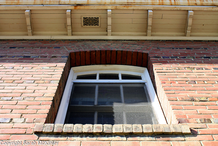 Looking up at the slightly arched window and eave of the Carnegie Library in Willits in Mendocino County in Northern California.