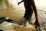A river laborer pulls a raft across the muddy 200-yard Suchiate River from Tecun Uman, Guatemala, to Hidalgo, Mexico, for 10 quetzales, or about one dollar and thirty cents, on Wednesday, May 9, 2007.