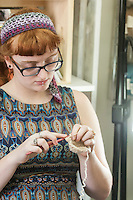 STAFF PHOTO ANTHONY REYES &bull; @NWATONYR<br /> ALL NAMES CQUED<br /> B'ney Landis, of Gentry, crochets a slipper Thursday, Sept. 18, 2014 during a crocheting and knitting class at Mockingbird Moon in Rogers.