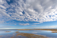 Clouds over the shoreline of Barter Island, looking north over the Beaufort Sea. Arctic, Alaska