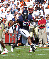 Oct 2, 2010; Charlottesville, VA, USA; Virginia Cavaliers linebacker Darnell Carter (57) in motion during the game against the Florida State Seminoles at Scott Stadium. Florida State won 34-14.  Mandatory Credit: Andrew Shurtleff-