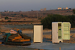 Mattresses and a refrigerator wait for supporters, at the Israeli outpost of Kerem Atzmona, in the Israeli settlement bloc of Gush Katif, in front of the Palestinian town of Khan Yunis, Gaza Strip.<br />