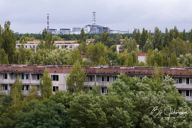 Chernobyl Nuclear Power Plant from the deserted town Pripyat.<br /> Pripyat was built 1970 as a modern city for personnel at the power plant. After the nuclear disaster at reactor 4 on April 26 1986, the town's 48.000 inhabitants was evacuated to other parts of the country. Pripiat is today a radioactive ghost town. The whole area is contamined with nuclear material, the half-life of plutonium-239 is more than 24.000 years.<br /> Pripyat and Chernobyl, Ukraine.<br /> August 2008.