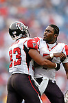 25 September 2005: Michael Vick (7, right), Quarterback for the Atlanta Falcons, is held back from the officials by Justin Griffith (33, left) after a play review was called in a game against the Buffalo Bills. The Falcons defeated the Bills 24-16 at Ralph Wilson Stadium in Orchard Park, NY.<br /><br />Mandatory Photo Credit: Ed Wolfstein.