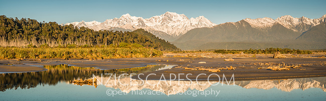 Gillespies Beach with Southern Alps, Mount Tasman and Mount Cook reflecting in Cook River in foreground, Westland Tai Poutini  National Park, UNESCO World Heritage Area, West Coast, New Zealand, NZ