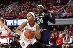 29 December 2016: NC State's Dominique Wilson (left) spins away from Notre Dame's Arike Ogunbowale (24). The North Carolina State University Wolfpack hosted the University of Notre Dame Fighting Irish at Reynolds Coliseum in Raleigh, North Carolina in a 2016-17 NCAA Division I Women's Basketball game. NC State won the game 70-62.