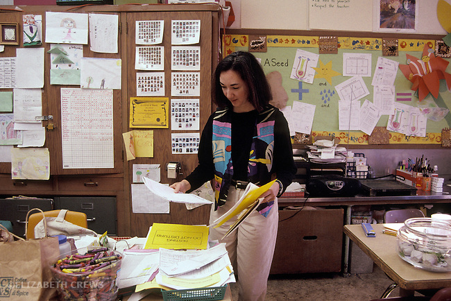 Oakland CA 2nd grade teacher sorting out papers during break