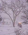 City workers struggle to keep a lane open throughout the blizzard of February 2010 in Rehoboth Beach, Delaware, USA.