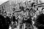 National Front march to Lewisham London 1977.<br /> <br /> Police protect members of the National Front, during the so-called Battle of Lewisham, which took place on 13 August. 500 members of the National Front marched from New Cross to Lewisham, various counter-demonstrations by approximately 4,000 people led to violent clashes between the two groups and between the anti-NF demonstrators and police. 5,000 police officers were present and 56 officers were injured in the riots, 11 of whom were hospitalised. 214 people were arrested for obstructing the police, threatening behaviour, assault, possession of an offensive weapon and throwing missiles. Later disturbances in Lewisham town centre saw the first use of police riot shields on the UK mainland.