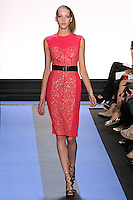 Tris walks runway in a magenta crepe cocktail dress with front corset sequin panel, by Monique Lhuillier, from the Monique Lhuillier Spring 2012 collection fashion show, during Mercedes-Benz Fashion Week Spring 2012.