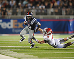 Ole Miss running back Jeff Scott (3) is chased by Fresno State linebacker Travis Brown (9)  at Vaught-Hemingway Stadium in Oxford, Miss. on Saturday, September 25, 2010. Ole Miss won 55-38.