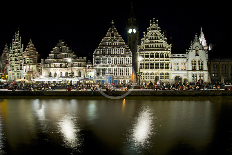 Belgium, Ghent, Graslei canal houses at night