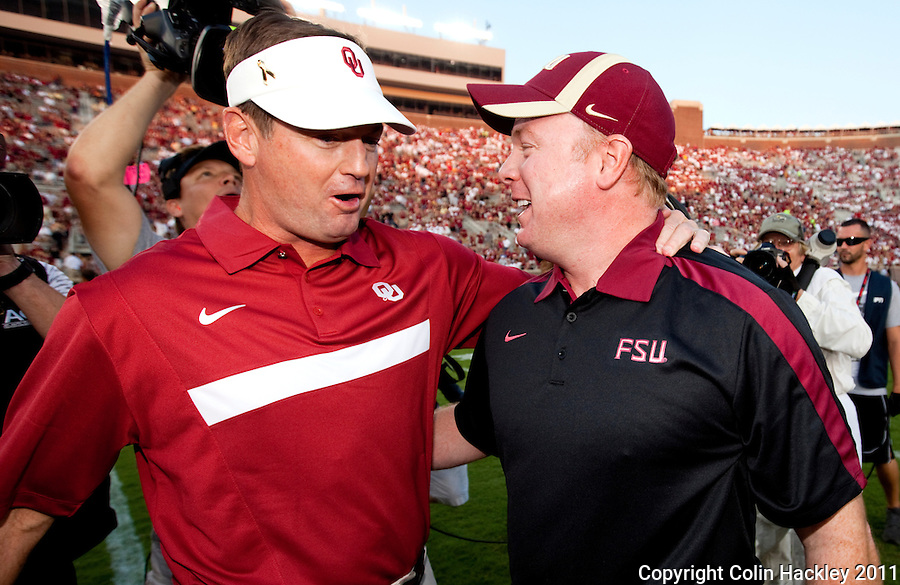 TALLAHASSEE, FL 9/17/11-FSU-OU091711 CH- Oklahoma Head Coach Bob Stoops, left, greets his brother Florida State Defensive Coordinator Mark Stoops prior to the game Saturday at Doak Campbell Stadium in Tallahassee. .COLIN HACKLEY PHOTO