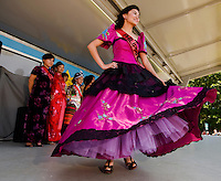 A woman dressed in a colorful traditional Philippine dress during the Charlotte Dragonboat Association racing on Lake Norman in NC.