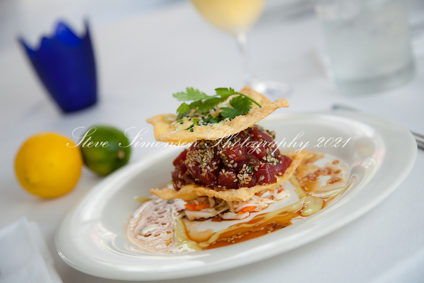 Bonsai bonsai burger appetizer, sashimi grade tuna tartar tossed in seasame dressing between crispy wontons.<br /> Restaurant Bacchus<br /> St Croix, U.S. Virgin Islands
