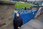 Matlock Town 0 Eastwood Town 3, 09/10/2010. Causeway Lane, FA Cup 3rd qualifying round. A spectator peering into the stadium before the FA Cup 3rd qualifying round tie between Matlock Town and Eastwood Town at Causeway Lane, Matlock. The visitors from Nottingham who play one division higher than Matlock won by three goals to nil to move to within one round of the FA Cup 1st round proper. The match was watched by 655 spectators. Photo by Colin McPherson.