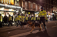 Police officers - 2011<br /> <br /> London, 14/12/2011. Thousands of Congolese people, activists and supporters gathered in Great Portland Street, outside the DR Congo embassy, to begin a march to Whitehall. They continue to protest against the alleged altered result of the election in their country, and to show the ongoing violence, atrocities, mass rapes and genocide that have been committed on the armless civilians in DR Congo. The march was peaceful, contained by a heavy police presence. In Whitehall  the atmosphere became tense as some bottles were thrown on the road and a few fireworks were thrown towards police vans, though no people were injured. The deadline for the demonstration, set up by the police and the organisers, was 18.00. The march led protesters towards Trafalgar Square, escorted by police officers and dogs, where they had agreed to disperse. A small group of protesters gathered opposite Charing Cross station, but were kettled by police officers to prevent disturbances in the area.