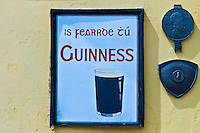 Guinness advertisement in Irish Gaelic in Timoleague, West Cork, Ireland
