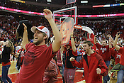NC State fans take the floor after the Wolfpack defeated the Duke Blue Devils 84-76, Raleigh, NC, Jan. 12, 2013.