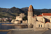 Eglise Notre Dame des Anges, Collioure, France, with Chateau Royal in the distance. The bell tower was converted from a medieval lighthouse and the Mediterranean Gothic style nave was built in 1684. The dome was added to the bell tower in 1810. Picasso, Matisse, Derain, Dufy, Chagall, Marquet, and many others immortalized the small Catalan harbour in their works. Picture by Manuel Cohen.