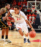 CHARLOTTESVILLE, VA- DECEMBER 6: Malcolm Brogdon #22 of the Virginia Cavaliers drives past Vertrail Vaughns #11 of the George Mason Patriots during the game on December 6, 2011 at the John Paul Jones Arena in Charlottesville, Virginia. Virginia defeated George Mason 68-48. (Photo by Andrew Shurtleff/Getty Images) *** Local Caption *** Malcolm Brogdon;Vertrail Vaughns