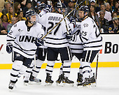 Stevie Moses (UNH - 22), (Campanale), Kevin Goumas (UNH - 27), (Borisenok), Mike Beck (UNH - 25) - The Merrimack College Warriors defeated the University of New Hampshire Wildcats 4-1 (EN) in their Hockey East Semi-Final on Friday, March 18, 2011, at TD Garden in Boston, Massachusetts.