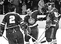 Seals score: Doug Roberts, Gary Jarrett, and Gerry Ehman celebrate..(1970 photo/Ron Riesterer)