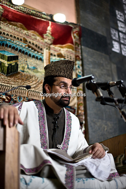 Chairman of the All Parties Hurriyat Conference, Mirwaiz Muhammad Umar Farooq is seen addressing the pious muslims who came to offer friday prayers in the Jamia Masjid in downtown Srinagar, summer capital of Jammu and Kashmir, India. A 50 hour curfew was imposed on May 5th to boycott the elections on May 7, 2009. ..Kashmir went into polls on the 4th round of Indian general elections. About 26 percent polling was recorded in the Indian parliamentary elections held in Kashmir on Thursday, May 7th 2009. The poll percentage was on the higher side this year as compared to 2004 polls when 15.04 percent polling was recorded.