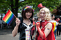 April 29, 2012, Tokyo, Japan -  Two men dressed as women are carrying the rainbow flag. The first Tokyo Rainbow Pride parade went from Yoyogi Park and went around the Harajuku area.  (Photo by Rodrigo Reyes Marin/AFLO) (JAPAN)   .