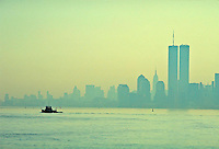 Lower Manhattan and Tugboat  at sunrise, New York City, New York, foggy morning