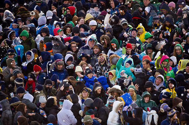 Nov. 23, 2013; The student section enjoys the tradition of a marshmallow fight at half time of the last football home game of the season.<br /> <br /> Photo by Matt Cashore