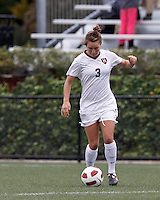 Harvard University midfielder Meg Casscells-Hamby (3) passes the ball. In overtime, Harvard University defeated Yale University,1-0, at Soldiers Field Soccer Stadium, on September 29, 2012.