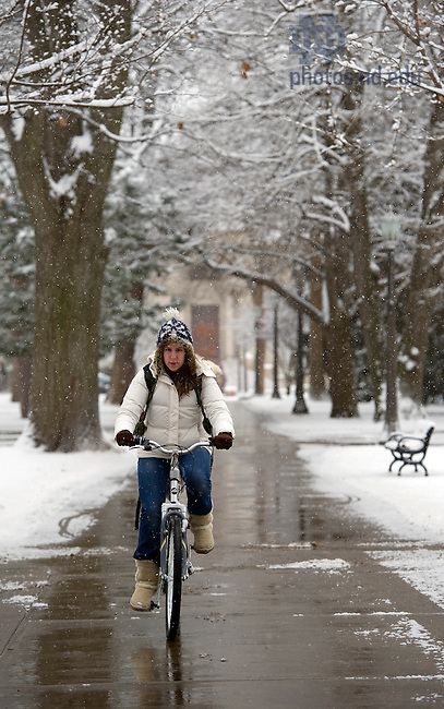 December 9, 2011; A student rides her bike on main quad. Photo by Barbara Johnston/University of Notre Dame.