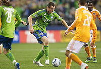 Seattle Sounders FC forward Nate Jaqua dribbles through a crowd of players during play against the Houston Dynamo at Qwest Field in Seattle Friday March 25, 2011. The match ended in a 1-1 draw.