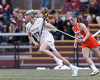 Boston College midfielder Mikaela Rix (17) brings the ball forward.   Syracuse University (orange) defeated Boston College (white), 17-12, on the Newton Campus Lacrosse Field at Boston College, on March 27, 2013.