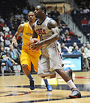 "Ole Miss' Murphy Holloway (31) drives vs. McNeese State's Dontae cannon (5) at the C.M. ""Tad"" Smith Coliseum in Oxford, Miss. on Tuesday, November 20, 2012. .."