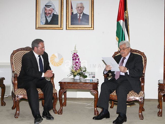 Palestinian President Mahmoud Abbas during a meeting with Secretary General of the Union for Popular Movement of France at the Palestinian President headquarters in the West Bank city of Ramallah on June 30, 2010. Photo by Thaer Ganaim