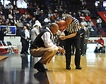 "LSU' head coach Trent Johnson and referee Tony Greene at the C.M. ""Tad"" Smith Coliseum in Oxford, Miss. on Saturday, February 25, 2012. (AP Photo/Oxford Eagle, Bruce Newman).."
