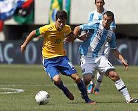 Brazil midfielder Oscar (10) dribbles as Argentina midfielder Javier Mascherano (14) defends. In an international friendly (Clash of Titans), Argentina defeated Brazil, 4-3, at MetLife Stadium on June 9, 2012.