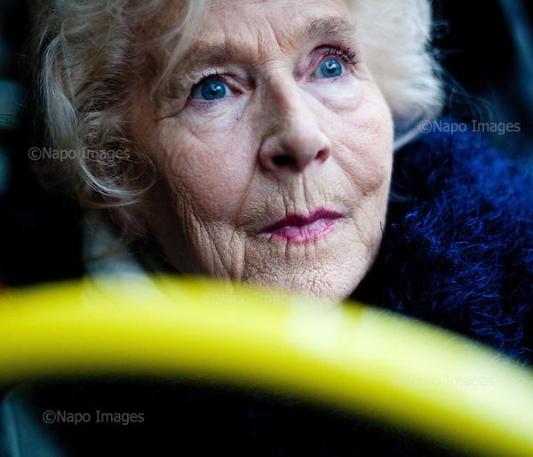 WARSAW, POLAND, NOVEMBER 2011:.Wika Szmyt, 74 year old DJ, sitting in the tram..Wika is famous in Poland for being the oldest DJ. Twice a week she runs discos at the Bolek club in Warsaw, frequented mainly by the pensioners..(Photo by Piotr Malecki/Napo Images)..WARSZAWA, LISTOPAD 2011:.DJ Wika w tramwaju. Wika Szmyt, 74-letnia DJ jest znana jako najstarsza didzejka w Polsce. Dwa razy w tygodniu prowadzi dyskoteki w klubie Bolek, na ktore przychodza glownie emeryci..Fot: Piotr Malecki/Napo Images.***ZAKAZ PUBLIKACJI W TABLOIDACH I PORTALACH PLOTKARSKICH*** .*** Zdjecie moze byc uzyte w prasie, gdy sposob jego wykorzystania oraz podpis nie obrazaja osob znajdujacych sie na fotografii ***.