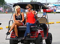 Sept. 1, 2014; Clermont, IN, USA; Kay Torrence (right) mother of NHRA top fuel driver Steve Torrence during the US Nationals at Lucas Oil Raceway. Mandatory Credit: Mark J. Rebilas-USA TODAY Sports