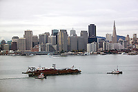 aerial photograph tug boats with loaded barge San Francisco skyline