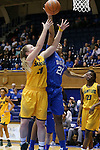 08 November 2015: Duke's Kendall Cooper (21) blocks a shot by Saint Leo's Abby Peterson (20). The Duke University Blue Devils hosted the Saint Leo University Lions at Cameron Indoor Stadium in Durham, North Carolina in a 2015-16 NCAA Women's Basketball Exhibition game. Duke won the game 116-33.